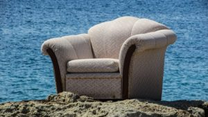 An armchair on the beach.