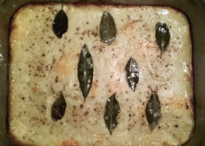 Scalloped potatoes, fresh out of the oven. (Please don't eat the bay leaves!)